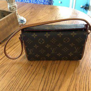 Authentic Louis Vuitton shoulder clutch bag.